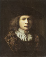 School of Rembrandt Portrait of a man wearing a beret and a cloak trimmet with brocade